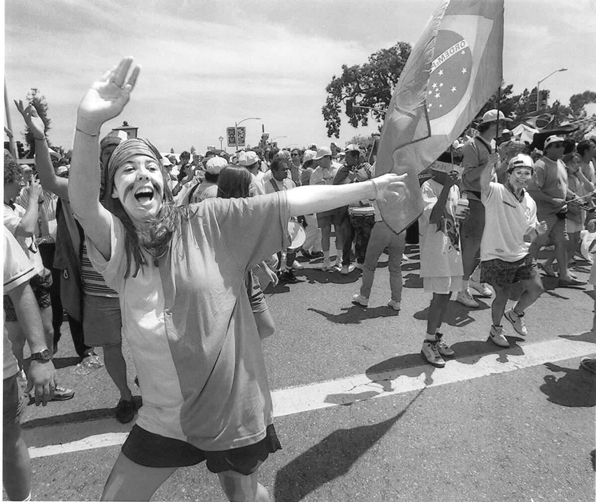 Brazilian fans dance to drums on El Camino and outside Stanford Stadium before start of the World Cup game, June 20, 1994
