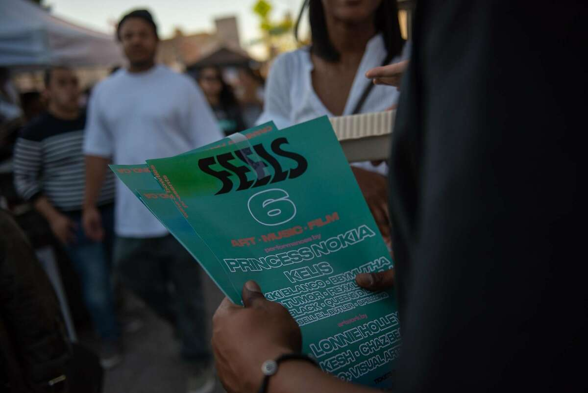Max Gibson holds posters promoting Feels 6 at Oakland�s First Friday on Friday, June 1, 2018.
