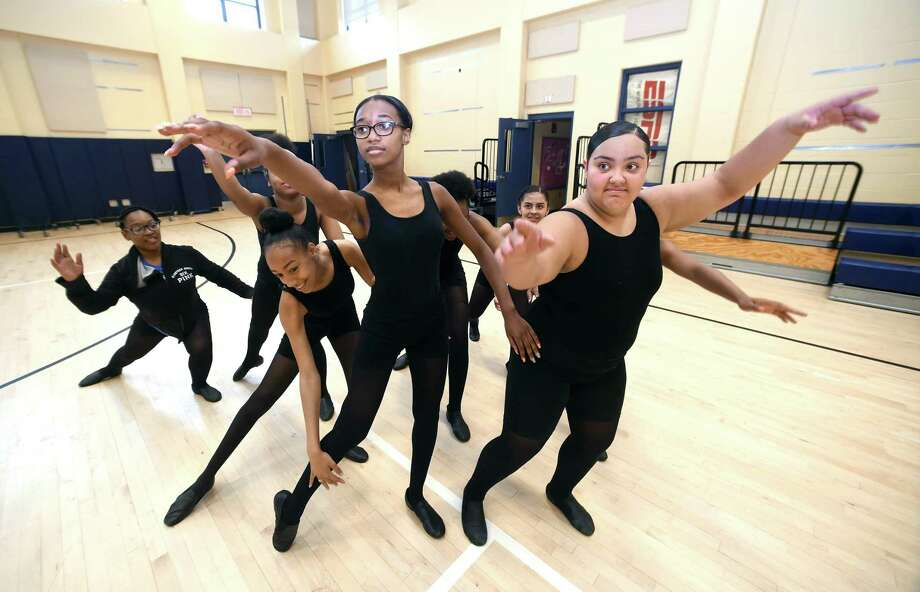 Craigrianna Golding, center left,  Chassity Ramirez, center right, and other members of the Co-op High School Dancers rehearse for their opening number in the Hill Central School Talent Show in New Haven Wednesday. Photo: Arnold Gold / Hearst Connecticut Media / New Haven Register