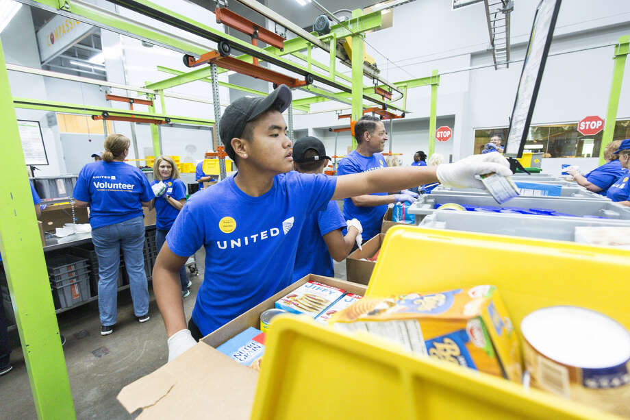 United Airlines employees volunteered at the Houston Food Bank on Wednesday, June 13, 2018. The airline also provided a $1 million grant. Photo provided by United Airlines.