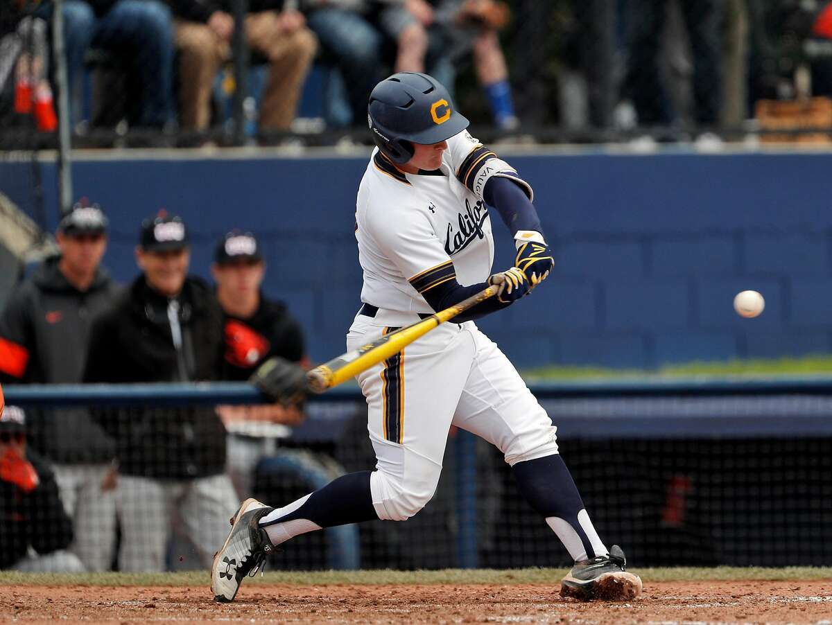 Andrew Vaughn (20) swings at a pitch as the Cal Bears played the Oregon State Beavers at Evans Field in Berkeley, Calif., on Sunday, March 18, 2018.