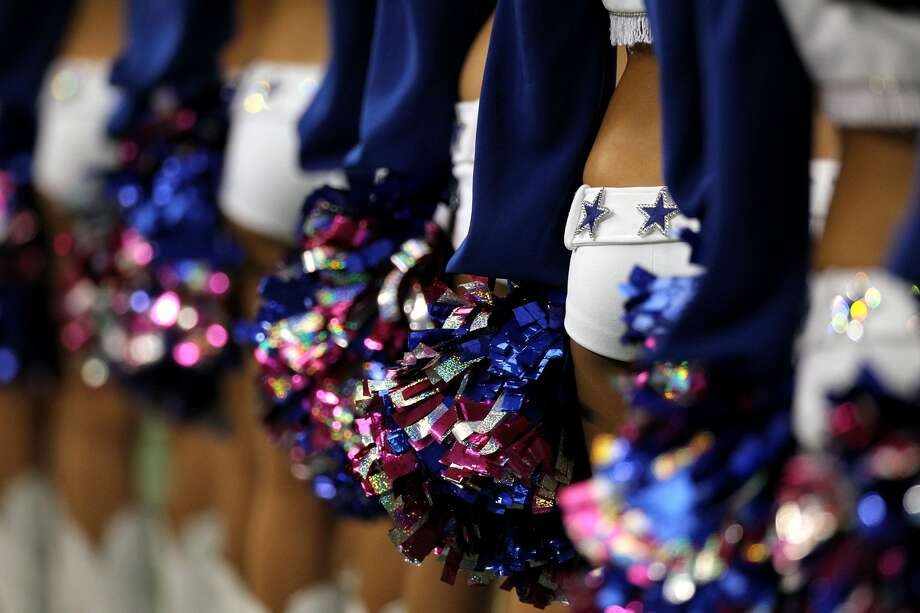 ARLINGTON, TX - OCTOBER 31:  A detail the Dallas Cowboys cheerleaders as they line up holding pom poms against the Jacksonville Jaguars at Cowboys Stadium on October 31, 2010 in Arlington, Texas.  (Photo by Ronald Martinez/Getty Images) Photo: Ronald Martinez/Getty Images