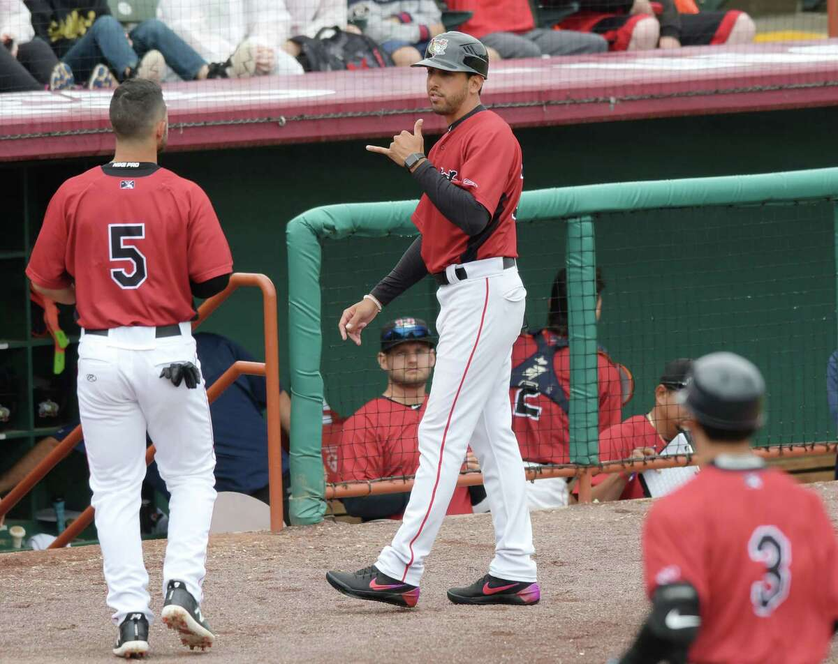 Tri-City ValleyCats manager Jason Bell, right, talks with player Kyle Davis during their exhibition game against the Albany Dutchmen on Wednesday, June 13, 2108, in Troy, N.Y. (Paul Buckowski/Times Union)