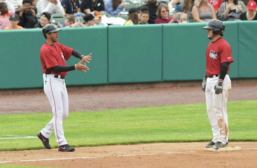 Tri-City ValleyCats manager Jason Bell, left, talks with player Oscar Campos during their exhibition game against the Albany Dutchmen on Wednesday, June 13, 2108, in Troy, N.Y. (Paul Buckowski/Times Union)