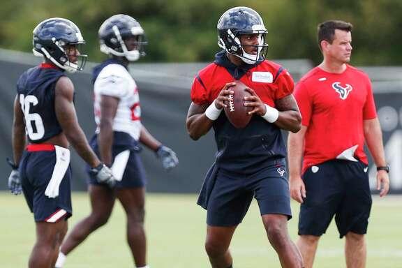 Houston Texans quarterback Deshaun Watson drops back to pass during mini camp at The Methodist Training Center on Wednesday, June 13, 2018, in Houston.
