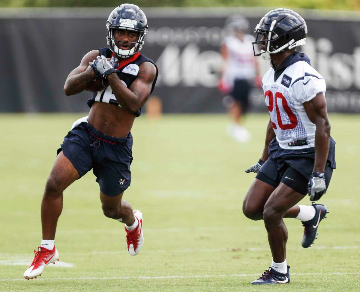 Houston Texans wide receiver Keke Coutee (16) runs with the ball after making a catch against cornerback Johnson Bademosi (20) during mini camp at The Methodist Training Center on Wednesday, June 13, 2018, in Houston.