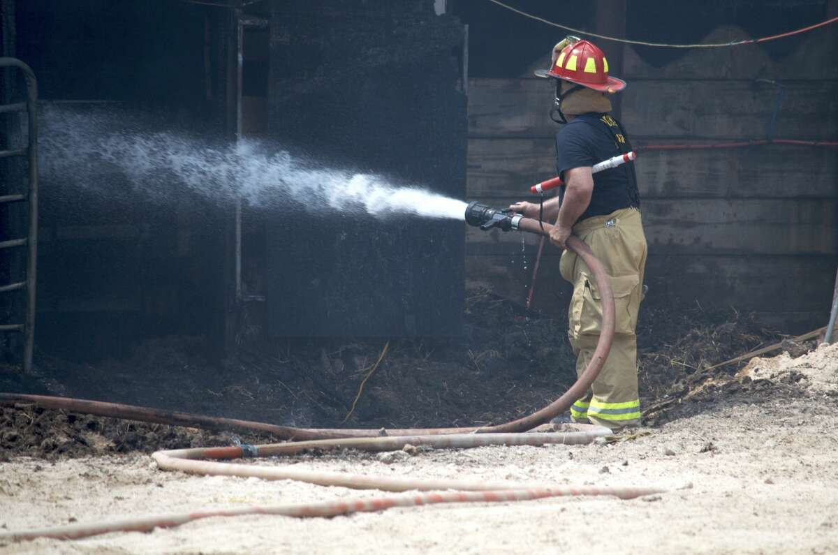 Houston firefighters battled a barn fire in the 6100 block of Wenlock Drive on Wednesday, June 13, 2018.