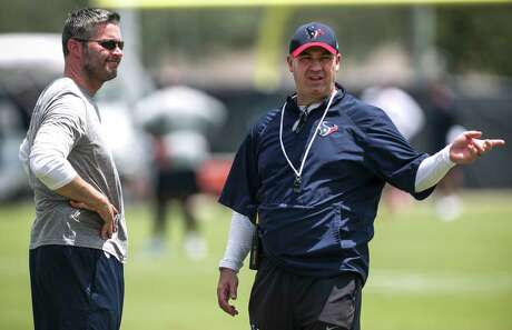 Houston Texans general manager Brian Gaine, left, and head coach Bill O'Brien talks during mini camp at The Methodist Training Center on Wednesday, June 13, 2018, in Houston.