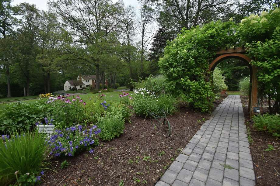 The Petit Memorial Garden at the site of the former Petit Family home in Cheshire, in 2017. On July 23, 2007, two men broke into the house at 300 Sorghum Mill Drive in Cheshire, killing Jennifer Hawke-Petit and her two daughters, 17-year-old, Hayley and 11-year-old Michaela. The house was set on fire and the only survivor, the victims' husband and father, Dr. William Petit Jr., escaped. Photo: Catherine Avalone / Hearst Connecticut Media File Photo / Catherine Avalone/New Haven Register