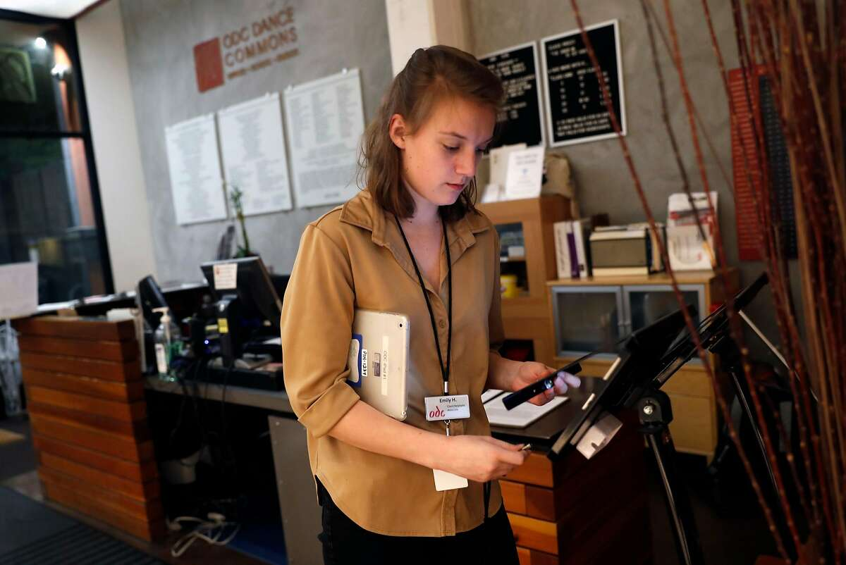 Emily Hansel, 23, a ballet and modern dancer, works a front desk shift at ODC Dance Commons in San Francisco, Calif., on Monday, January 22, 2018.