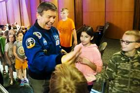 NASA astronaut Michael Barratt greets students after giving a talk at Central Park Elementary on Wednesday, June 13, 2018. Barratt will also give a talk on Wednesday evening as part of the Matrix: Midland Festival at the Midland Center for the Arts. (Katy Kildee/kkildee@mdn.net)