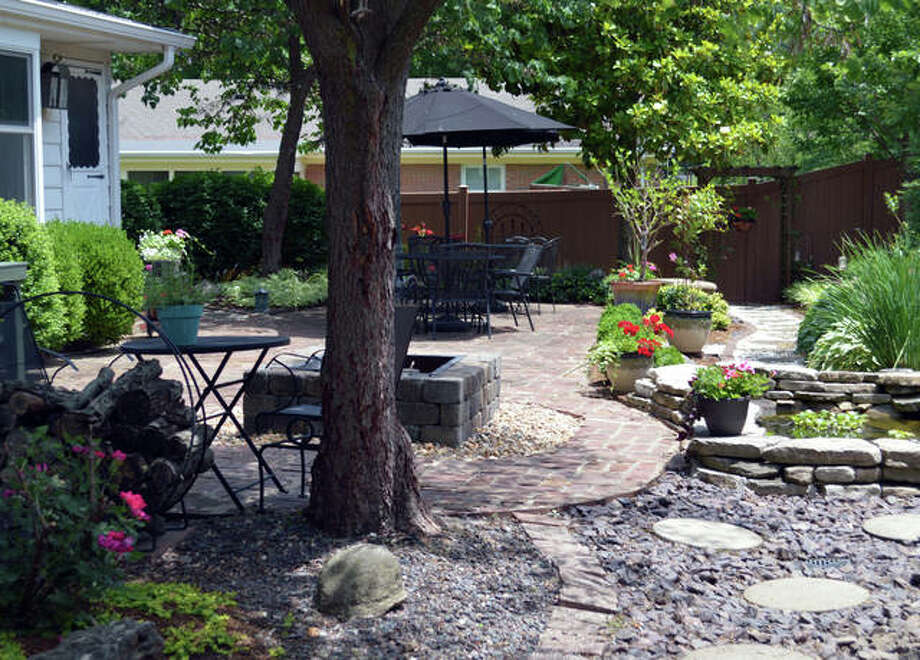 The courtyard in the Maneke/Loucks gardens have been the sight of many family gatherings, showers and other events. Photo:       Vicki Bennington | For The Telegraph
