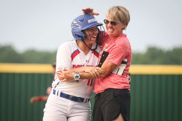Oak Ridge's Stephani Rougeau, right, celebrates with Autumn Sydlik during the 2018 season. Rougeau takes over as the Lady War Eagles head coach in 2019.