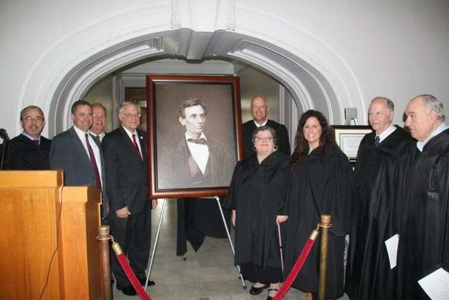 Pictured in the photograph taken at the dedication are, from left, Judge David Dugan, Justice David Overstreet, IJA President Judge John Coady, ISBA 3rd VP Dennis Orsey, Chief Judge David Hylla, Judge Barbara Crowder, Judge Sarah Smith, Justice Tom Welch and Judge Andreas Matoesian. Photo:       For The Telegraph