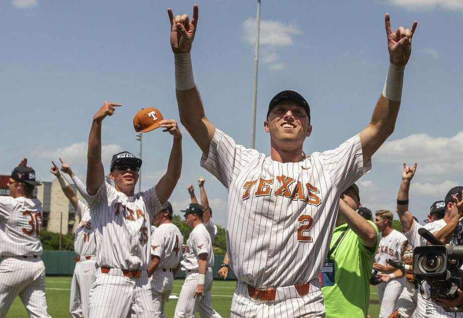 Texas' Tristan Stevens (35) and Kody Clemens (2) celebrate a 5-2 win over Tennessee Tech during an NCAA Super Regional in Austin on Monday. Photo: Stephen Spillman / Stephen Spillman / stephenspillman@me.com Stephen Spillman