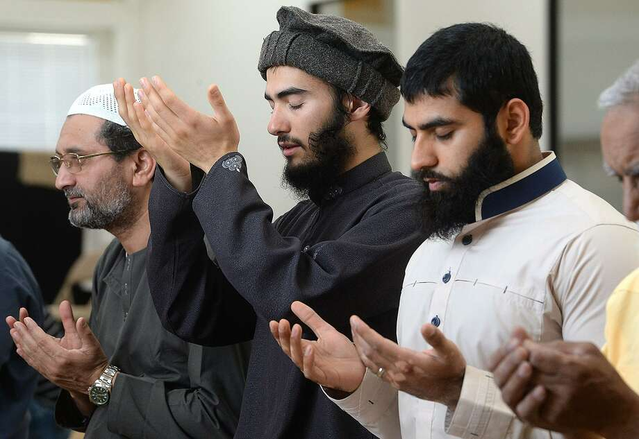 From right, Imam Taha Khan, Isa Ahsan of Lumberton and Shawn Javed join in afternoon prayers at the Islamic Center of Triplex - Beaumont Mosque. Prayer services and fast-breaking feasts have been held at the Center throughout the 30 days of Ramadan, which ends at sundown Thursday, June 14. Final prayer services will begin at 8:16 p.m. with a feast to follow. Services and meals are open to the public. The Center will hold Eid festivities Friday morning, beginning with a breakfast from 8:30 - 9:00 a.m. Photo taken Wednesday, June 13, 2018 Kim Brent/The Enterprise Photo: Kim Brent / The Enterprise / BEN