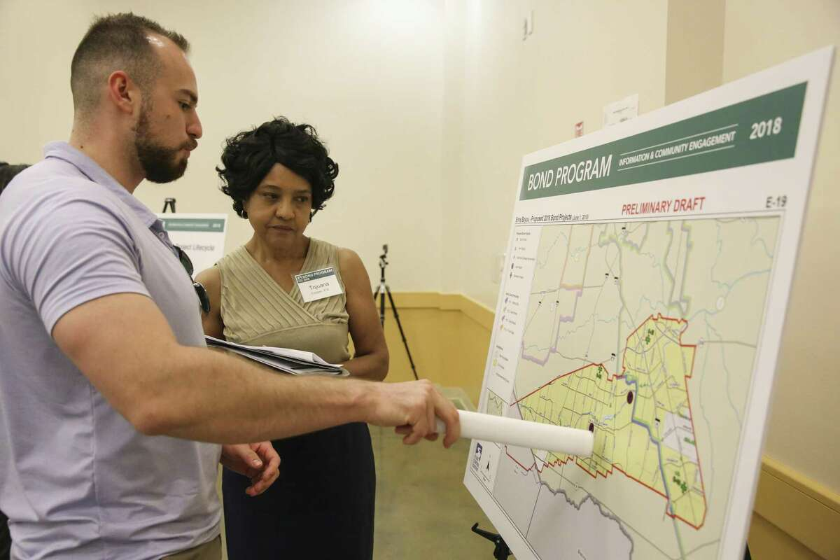 Veso Kossev talks to Harris County Flood Control District engineer Tojuana Cooper regarding to the Sims Bayou area during the agency's first community meeting on the $2.3 billion flood bond at the Hiram Clarke Multi-Service Center on Tuesday, June 5, 2018, in Houston. Kossev came to the meeting to find out the agency's plans because he owns properties near different creeks in Harris County. ( Yi-Chin Lee / Houston Chronicle )
