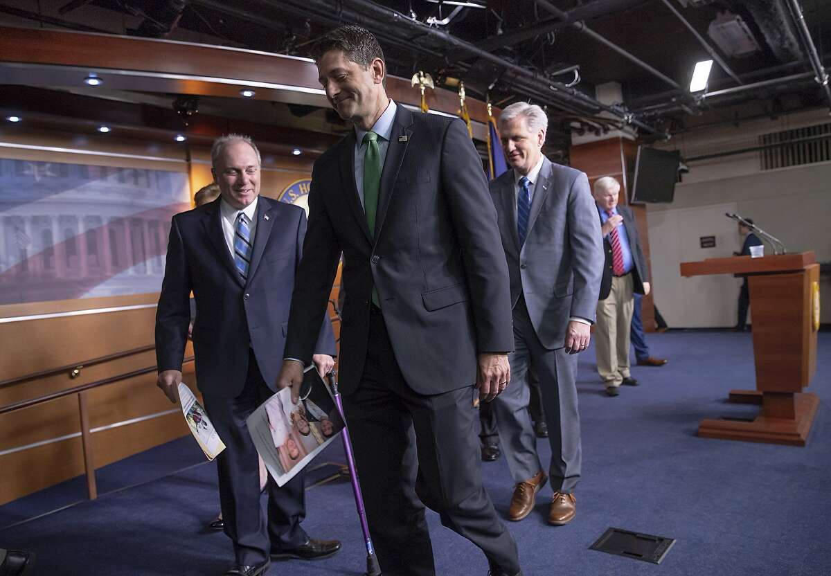 """Speaker of the House Paul Ryan, R-Wis., flanked by House Majority Whip Steve Scalise, R-La., left, and Majority Leader Kevin McCarthy, R-Calif., departs a news conference following a closed-door GOP meeting on immigration, on Capitol Hill in Washington, Wednesday, June 13, 2018. The Wisconsin Republican gave an upbeat assessment to reporters after brokering a deal between party factions on a process to consider rival GOP immigration plans to protect young """"Dreamer"""" immigrants brought illegally to the U.S. as children.(AP Photo/J. Scott Applewhite)"""