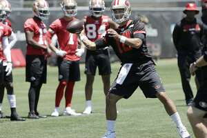 San Francisco 49ers Jimmy Garoppolo (10) passes during NFL football practice at the team's headquarters in Santa Clara, Calif., Wednesday, June 13, 2018. Year one under coach Kyle Shanahan was a bit of a whirlwind for the San Francisco 49ers with new systems to install and a midseason quarterback change to Jimmy Garoppolo. It's far different this year as the Niners wrap up the offseason program. (AP Photo/Jeff Chiu)
