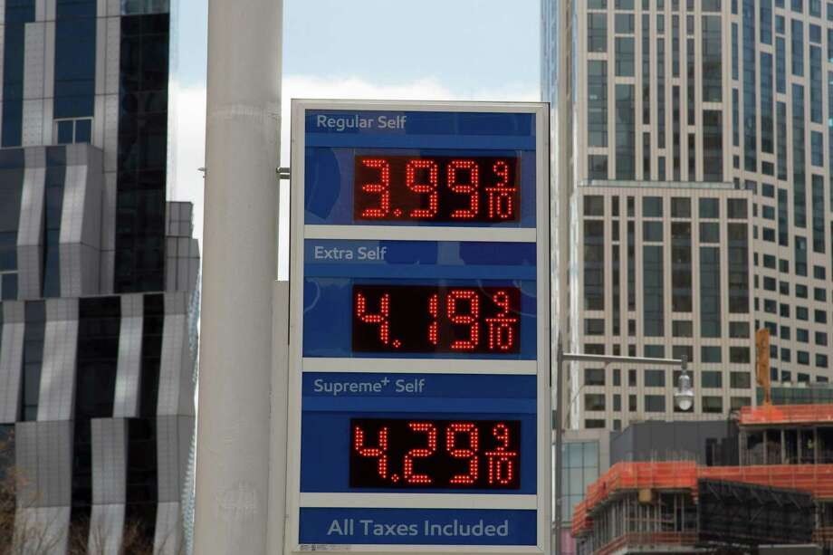"""In this April 18, 2018, file photo, gas prices are displayed at a Mobil station in New York. President Donald Trump is declaring that oil prices are too high and blaming a coalition of countries that control a significant portion of the world's supply of crude petroleum. Trump tweeted on Wednesday: """"Oil prices are too high, OPEC is at it again. Not good!"""" Photo: Mark Lennihan /Associated Press / Copyright 2018 The Associated Press. All rights reserved."""