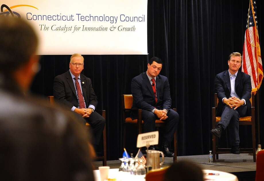 From left; Republican candidates for governor Mark Boughton, Tim Herbst, and Steve Obsitnik field questions from the audience during a gubernatorial forum sponsored by the CT Technology Council at the Trumbull Marriott in Trumbull, Conn. on Wednesday, June 13, 2018. Photo: Brian A. Pounds / Hearst Connecticut Media / Connecticut Post