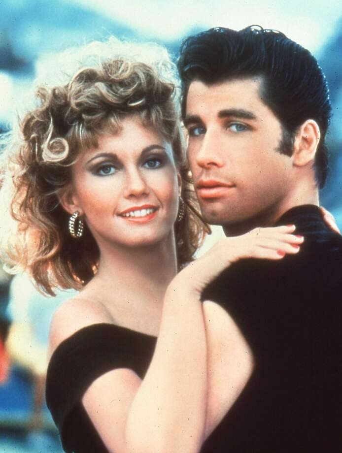 """""""Grease"""" (1978) Little Man rating: Empty Chair (we think)  The Chronicle's review of this still-beloved musical doesn't include a Little Man, but let's just say it doesn't leave much room for doubt: """"What is the audience for 'Grease?'"""" writes John L. Wasserman. """"What is the world moron population?""""  While """"Grease"""" won't rival """"Citizen Kane"""" for greatest movie of all time, and you might say it's just a series of lovable dance scenes, it turned out to have a large audience indeed, and people still dress up as John Travolta's and Olivia Newton-John's characters.  We'll add this line from Wasserman for good measure: """"The screenplay is a pre-pubescent shambles, the direction is by acne out of disposable douches, the dubbing and looping of the songs is painfully obvious, the characterizations are generally repulsive and the whole thing is utterly without style.""""  Photo: Handout, TNS"""