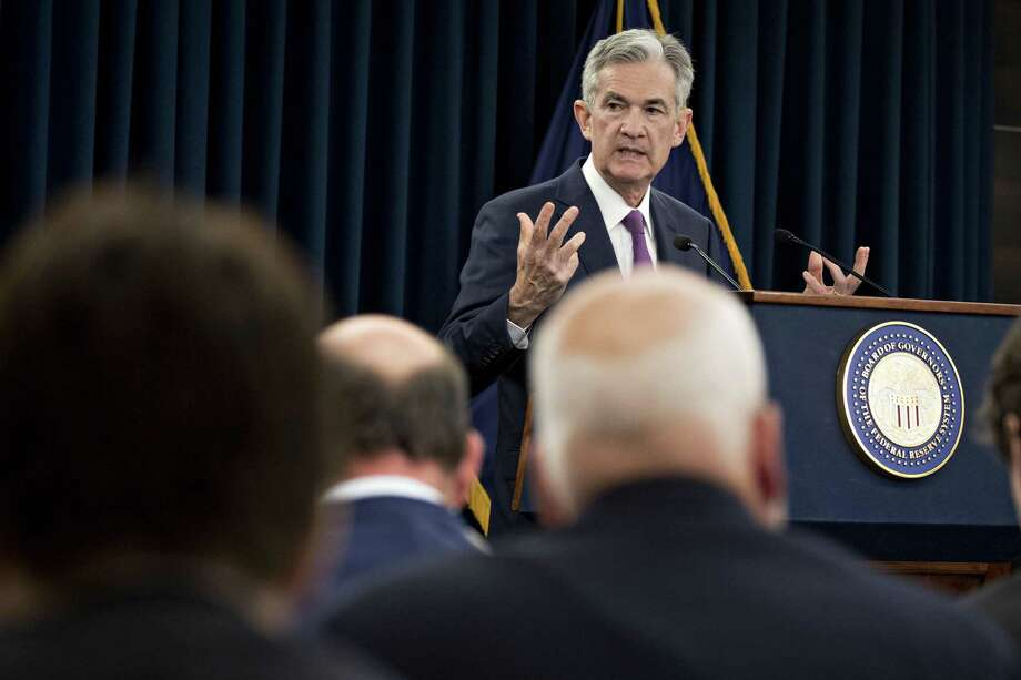 Jerome Powell, chairman of the U.S. Federal Reserve, speaks during a news conference following a Federal Open Market Committee (FOMC) meeting in Washington, D.C., U.S., on Wednesday, June 13, 2018. Federal Reserve officials raised interest rates for the second time this year and upgraded their forecast to four total increases in 2018, as unemployment falls and inflation overshoots their target faster than previously projected. Photo: Andrew Harrer /Bloomberg / © 2018 Bloomberg Finance LP