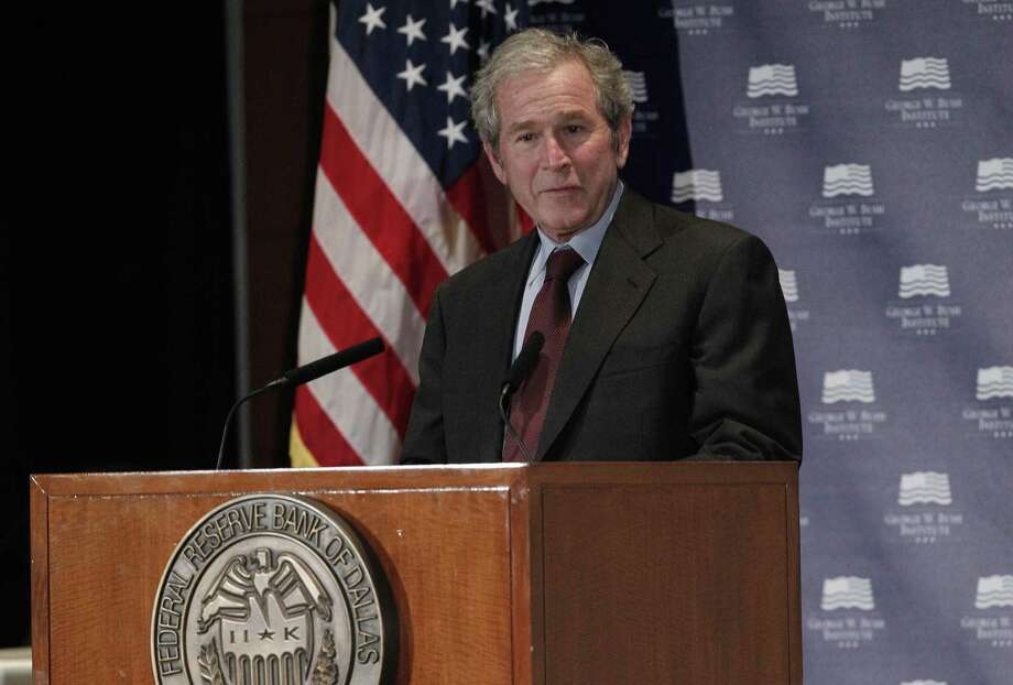 Former President George W. Bush gives opening remarks at the Federal Reserve Bank of Dallas in 2012. A reader says he is unfairly blamed for the 2008 economic collapse. Photo: LM Otero /AP / Associated Press