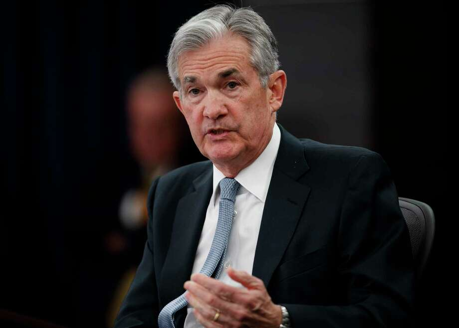 FILE- In this March 21, 2018, file photo, Federal Reserve Chairman Jerome Powell speaks following the Federal Open Market Committee meeting in Washington. Investors are eagerly awaiting the updated economic forecasts the Fed will issue when its meeting ends Wednesday, June 13. (AP Photo/Carolyn Kaster, File) Photo: Carolyn Kaster / Copyright 2018 The Associated Press. All rights reserved.