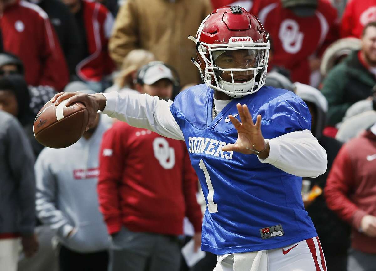 FILE - In this April 14, 2018, file photo, Oklahoma quarterback Kyler Murray (1) passes during an NCAA college football spring intrasquad game in Norman, Okla. (AP Photo/Sue Ogrocki, File)