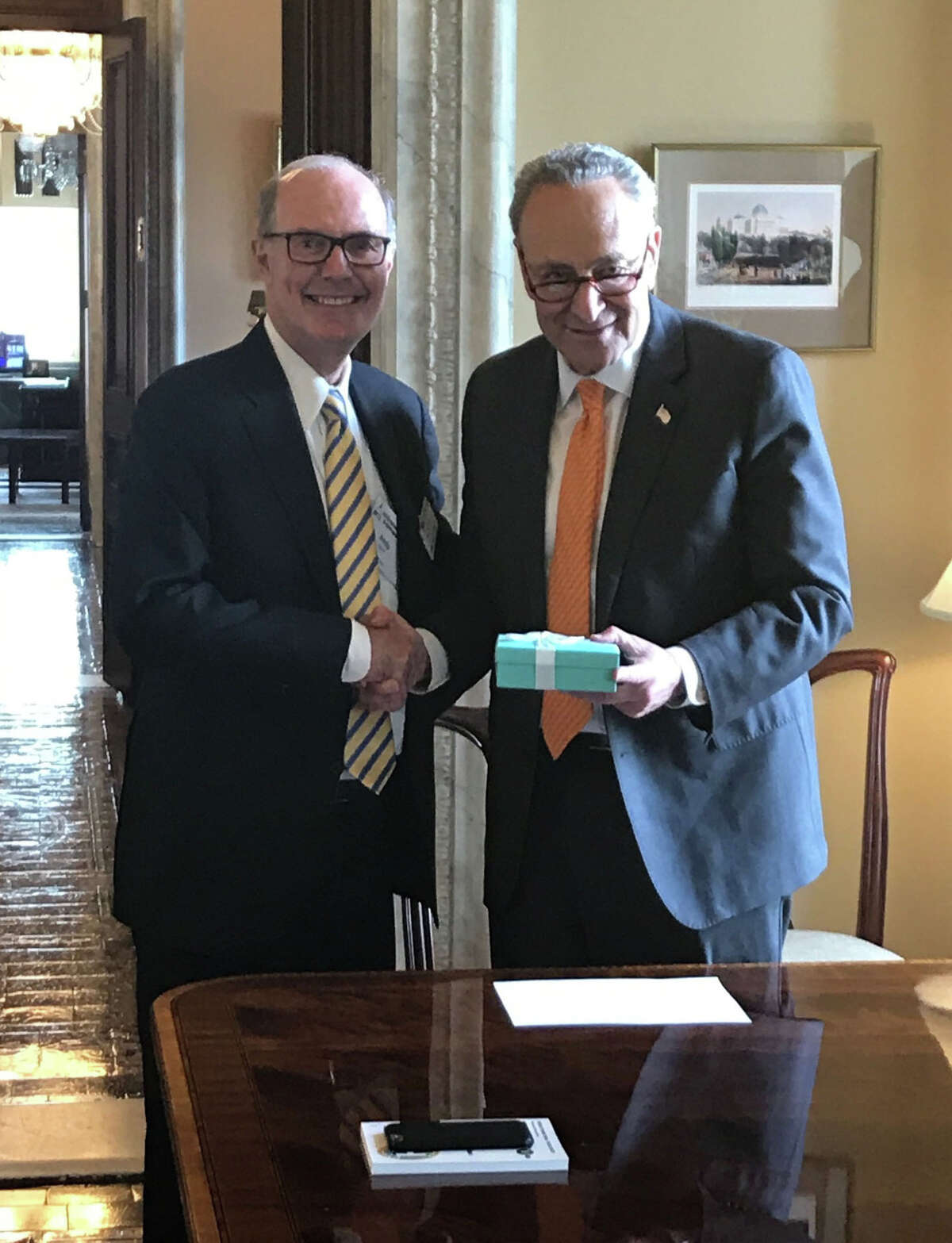 Plug Power CEO Andy Marsh, left, with U.S. Sen. Chuck Schumer of New York in Washington, D.C. Marsh presented Schumer with a special award for pushing through a tax credit on fuel cell purchases. ORG XMIT: MER2018061309315726