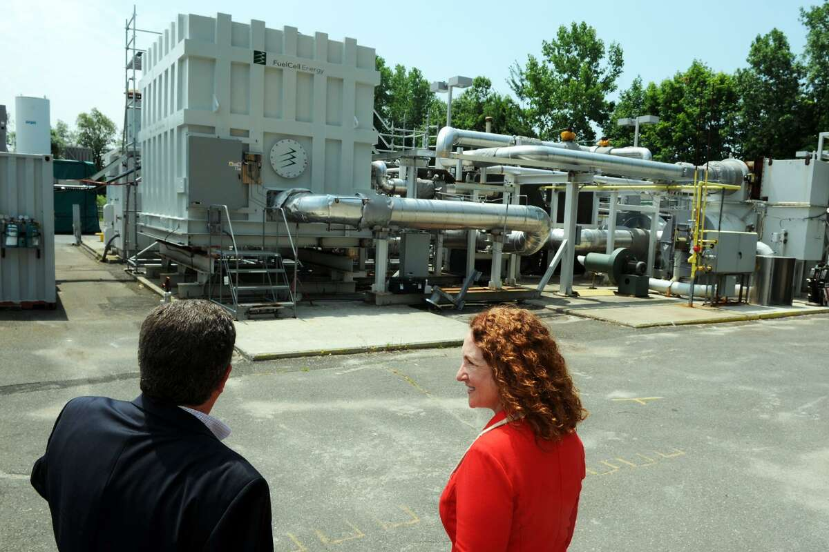 Anthony Rauseo, Senior Vice President and Chief Operating Officer for FuelCell Energy, leads U.S. Rep. Elizabeth Esty on a tour of the companyís facility in Danbury in 2014. FuelCell Energy was selected from among 27 bidders vying to provide renewable power under a request for clean energy.