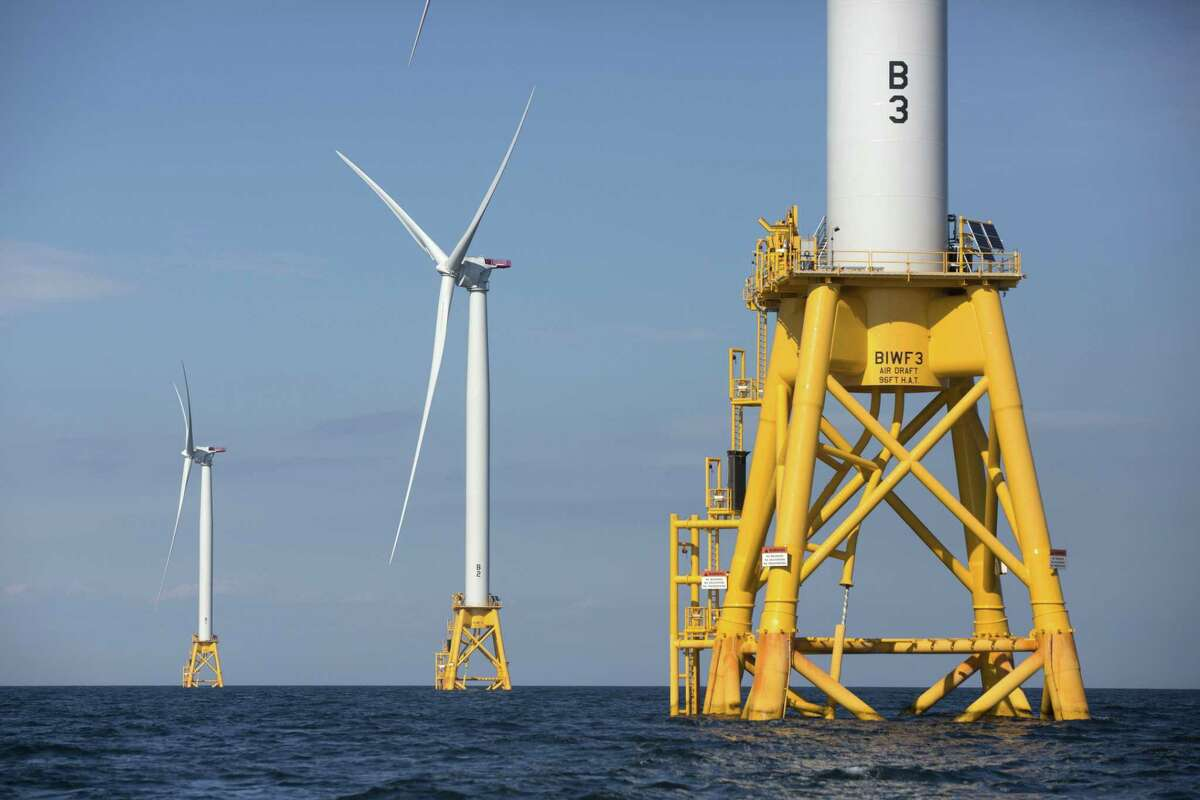 Three of Deepwater Wind's five turbines stand in the water off Block Island, R.I, the nation's first offshore wind farm. Deepwater Wind was selected from among 27 bidders vying to provide renewable power under a request for clean energy.