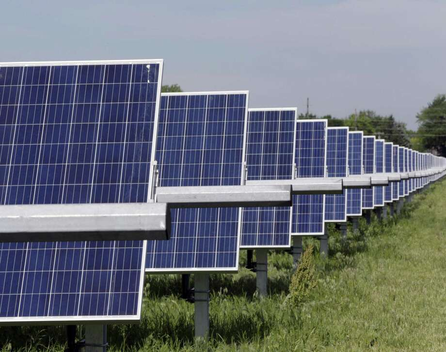 PHOTOS: How to save money on electricityA solar array like this one can generate more power for Houston, but how can you conserve power? >>>These tips are especially important in the summer... Photo: Nati Harnik, STF / Associated Press / Copyright 2018 The Associated Press. All rights reserved.