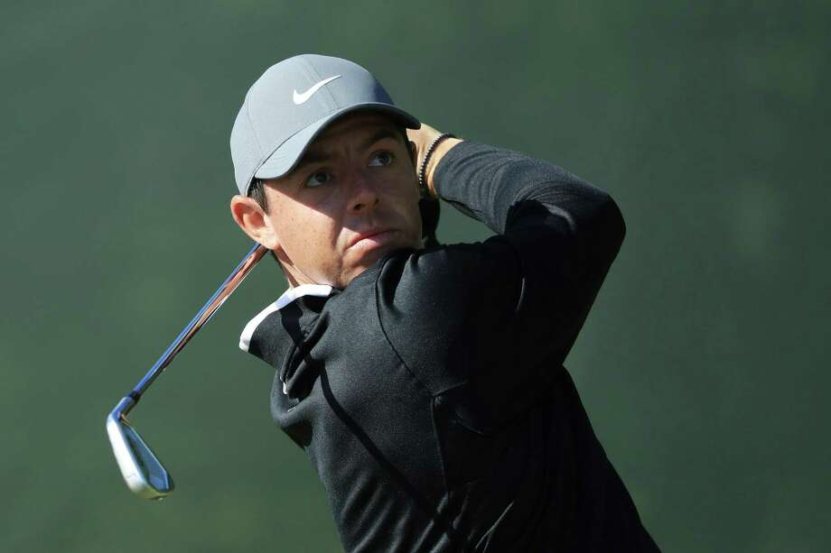 Rory McIlroy plays a shot on the second hole during a practice round  Tuesday prior to
