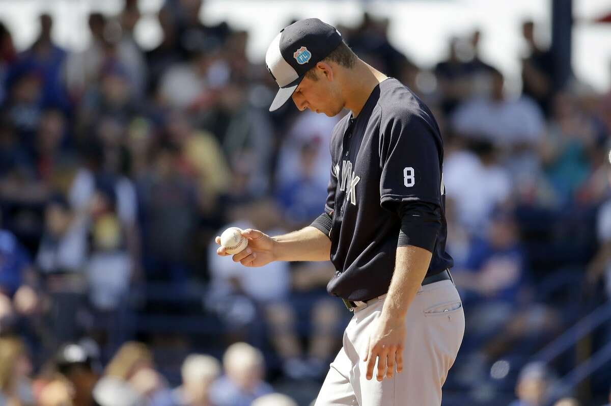 New York Yankees pitcher James Kaprielian pauses on the mound during the fifth inning of an exhibition spring training baseball game against the New York Mets Wednesday, March 9, 2016, in Port St. Lucie, Fla. (AP Photo/Jeff Roberson)