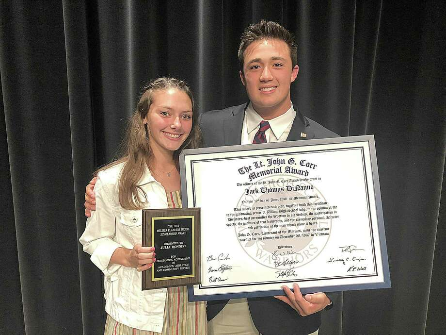 Wilton High senior athletes Julia Bonnist, left, and Jack DiNanno won the top two honors during the school's annual Senior Athletic Awards night Tuesday at the Clune Auditorium. Photo: John Nash /Hearst Connecticut Media