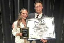 Wilton High senior athletes Julia Bonnist, left, and Jack DiNanno won the top two honors during the school's annual Senior Athletic Awards night Tuesday at the Clune Auditorium.