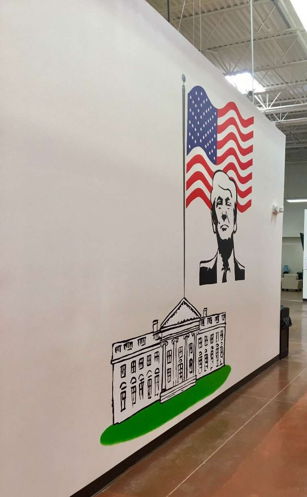 One of the largest shelters for unaccompanied minors in Texas includes a wall-sized mural of President Donald Trump.