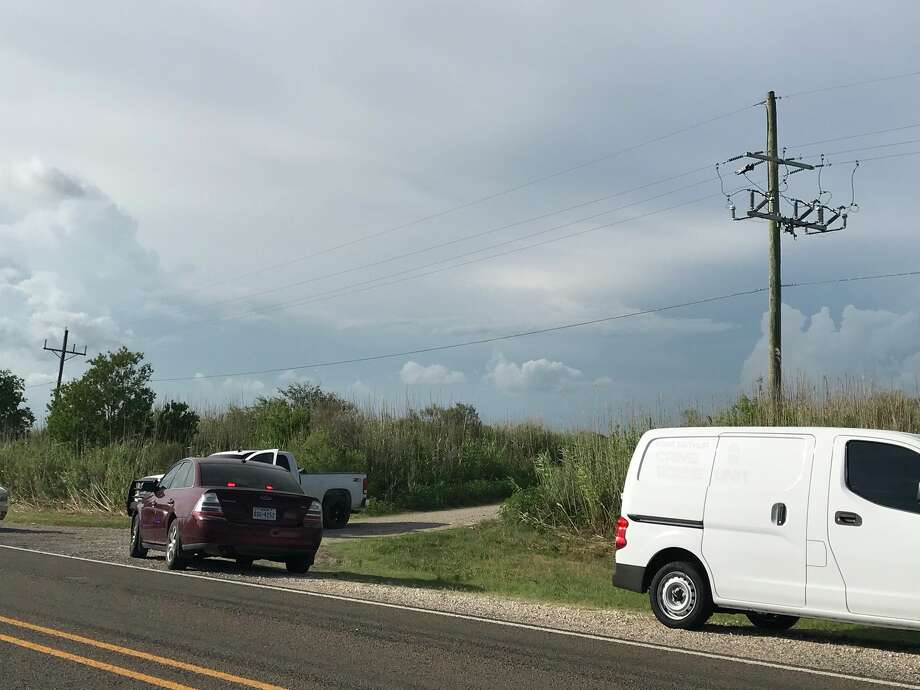 Crime scene units set up on Texas 82 in Pleasure Island after a report of a body being found Wednesday, June 13, 2018.