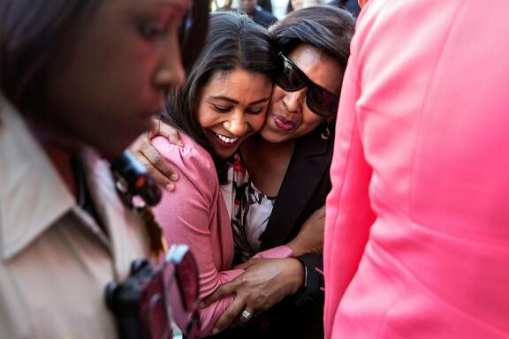 San Francisco mayoral candidate London Breed hugs San Francisco Port Commission President Kimberly Brandon following a press conference Wednesday, June 13, 2018 at City Hall in San Francisco, Calif. after fellow candidate Mark Leno called Breed to concede to her.