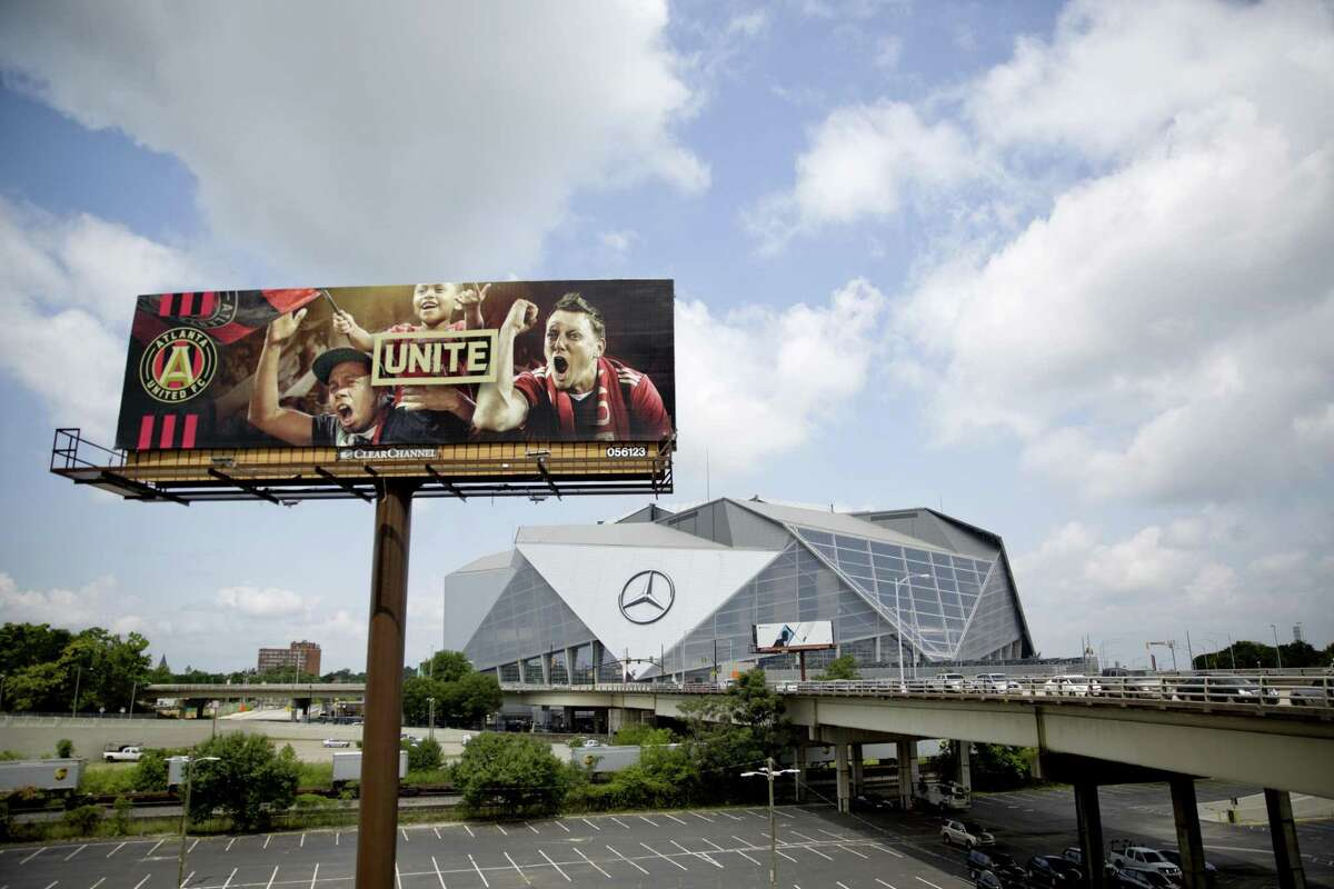 A billboard for Atlanta's MLS soccer team stands next to Mercedes-Benz Stadium where the team plays in Atlanta, Wednesday, June 13, 2018. The 2026 World Cup will return to the U.S. for the first time since 1994. (AP Photo/David Goldman)