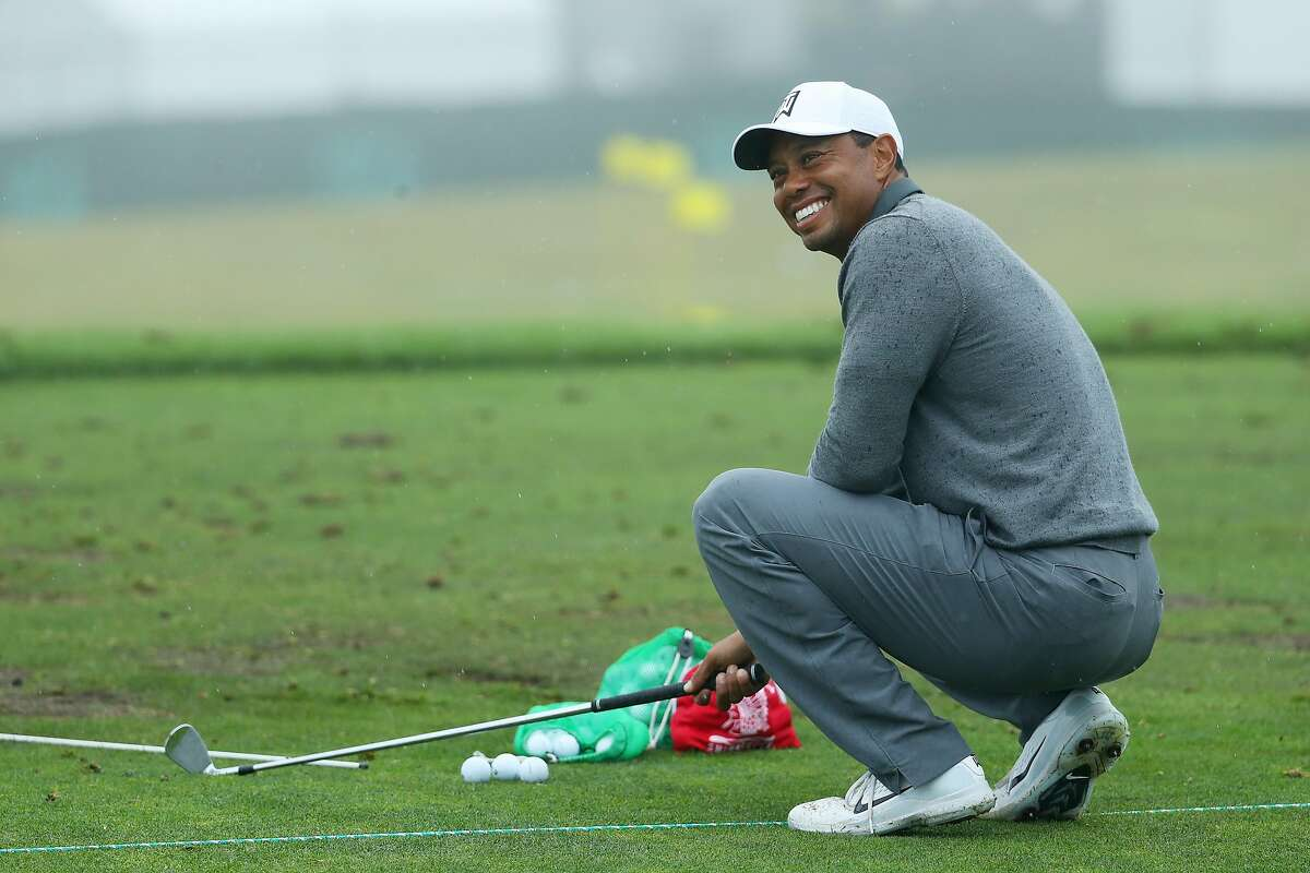SOUTHAMPTON, NY - JUNE 13: Tiger Woods of the United States smiles on the range prior to the 2018 U.S. Open at Shinnecock Hills Golf Club on June 13, 2018 in Southampton, New York. (Photo by Warren Little/Getty Images)