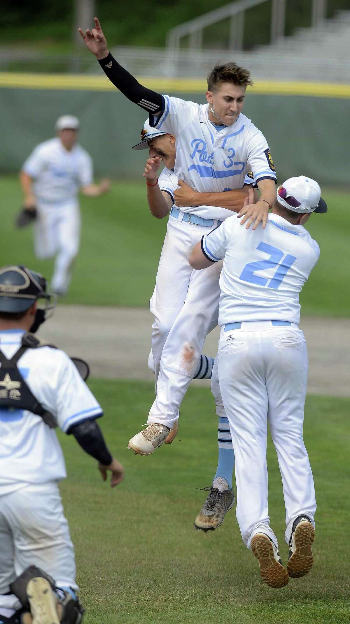 Stamford pitcher Aaron D'Annolfo celebrates with Adam Stone and Leo Socci after defeating West Hartford in the Senior American Legion championship series at Palmer Field on July 29 in Middletown.
