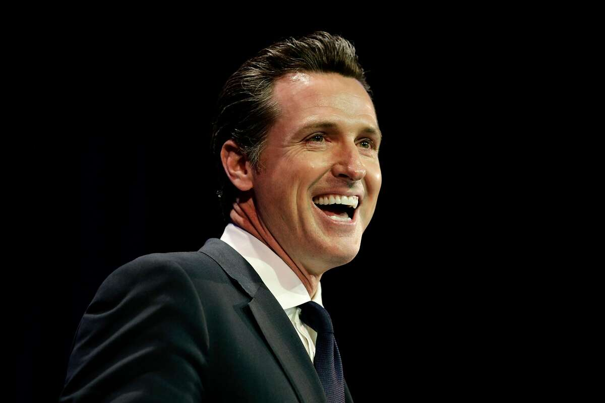 FILE - In this Saturday, March 8, 2014 file photo, California Lt. Gov. Gavin Newsom smiles while speaking at the California Democrats State Convention in Los Angeles. Newsom says he will begin raising money to run for California governor in 2018. In a written announcement Wednesday, Feb. 11, 2015, the Democrat says he passionately believes