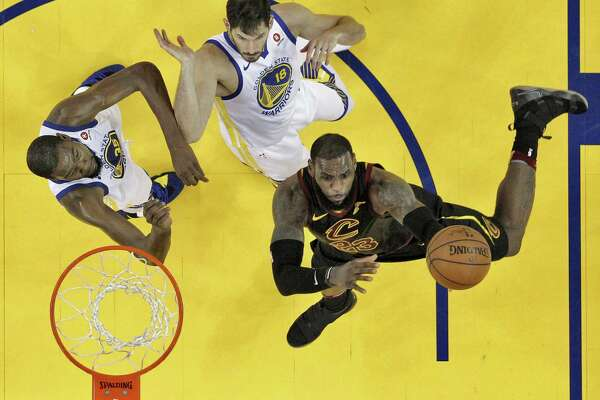 3bb2866657b 1of8LeBron James (23) shoots while defended by Kevin Durant (35) and Omri  Casspi (18) in the first half as the Golden State Warriors played the  Cleveland ...