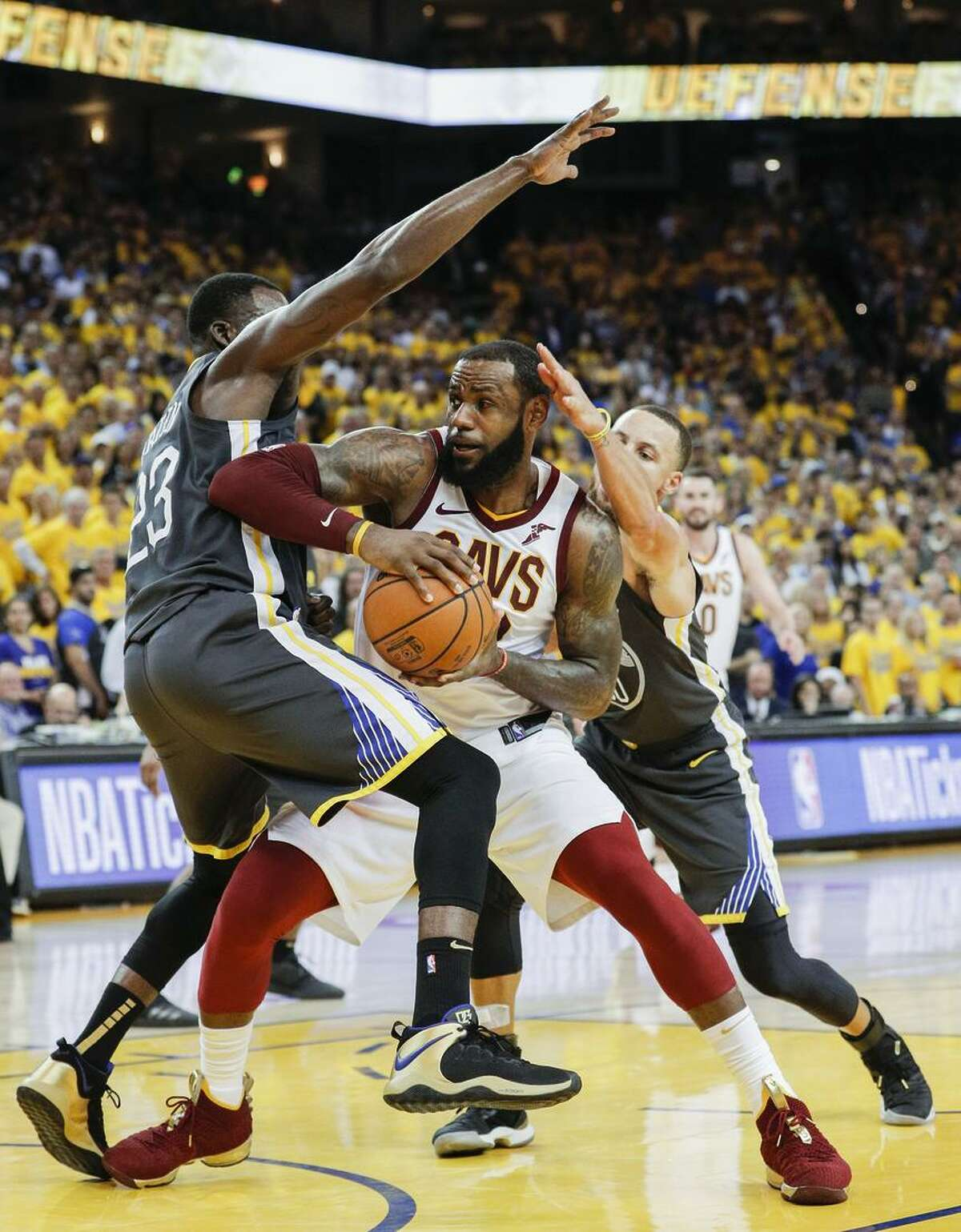 LeBron James gives Draymond Green the elbow treatment - probably while traveling - during Game 2 of the Finals.