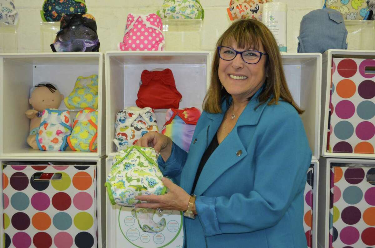 Sandra Beck, founder and CEO of Tidy Tots Diapers, poses with her product, which is available online at Buy Buy Baby, Bed Bath & Beyond, Walmart, JC Penny and Amazon. (Caroline Boardman, Buzz Media Solutions)