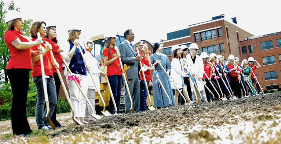 Care providers and leadership of OSF HealthCare Saint Anthony's Health Center participate in a ceremonial groundbreaking of a new $14 million cancer treatment center on the hospital's campus. Photo:       Nathan Woodside | The Telegraph
