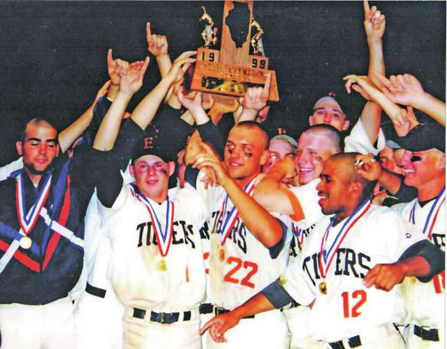 Class AA baseball state tournament co-MVPs Matt Evers (22) and Chad Opel (center, left) join Edwardsville Tigers teammates in hoisting the state championship trophy in Geneva after completing a 40-0 season in 1998 to claim the program's second state title. At far left is James Hutton, who threw a complete-game to secure the title. Photo:       Hearst File Photo